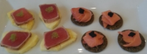 Tuna rumaki with wasabi on pineapple and lox on gluten-free rice cracker.